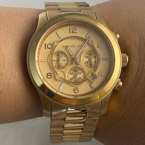 Michael Kors analog rose gold tone designer watch